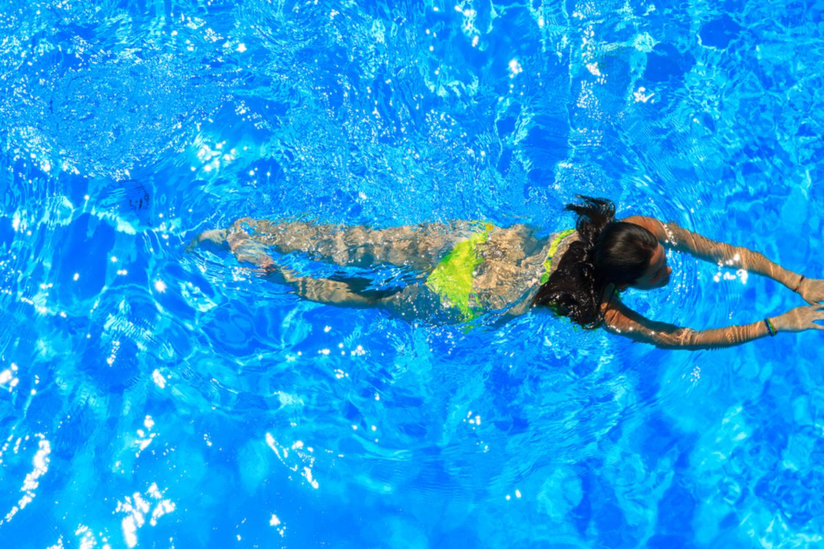 """Image via <a href=""""http://www.shutterstock.com/pic-143405392/stock-photo-woman-with-swimsuit-swimming-on-a-blue-water-pool.html?src=gioOzaGEKS01gcQ05G6EJQ-1-8"""">Netfalls - Remy Musser</a>/Shutterstock</span></p>"""