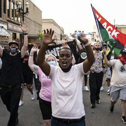 Protesters march around Kenosha in the second night of unrest after police shot Jacob Blake, Monday night, Aug. 24, 2020.