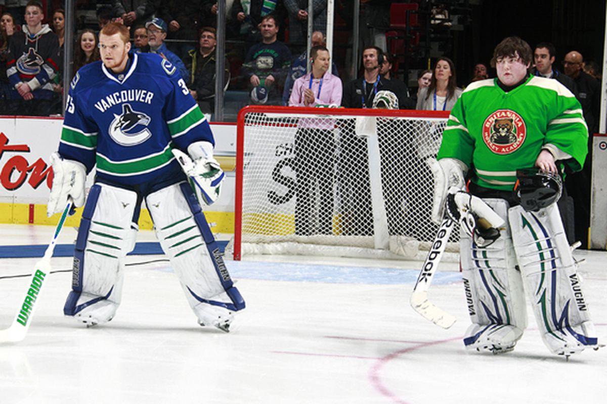 Vancouver Canucks goalie Cory Schneider (left) and Cory Oskam