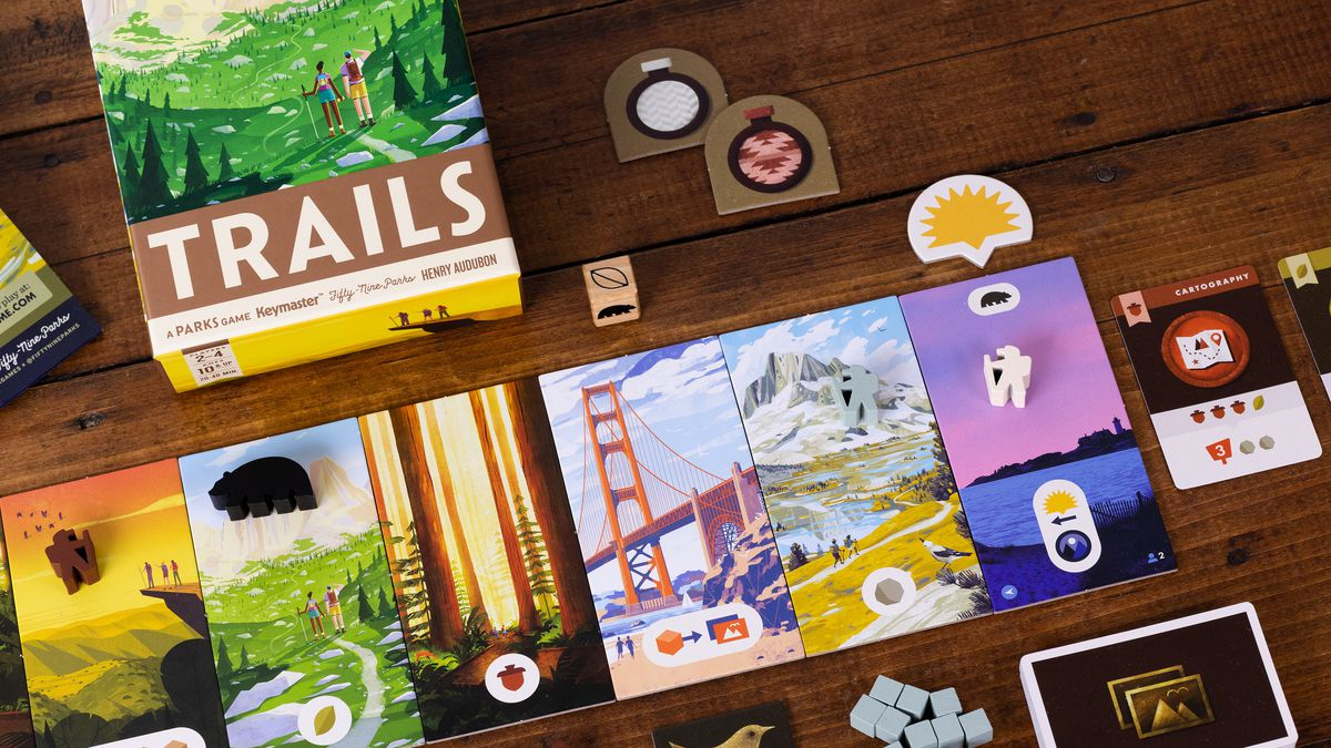 A game of Trails set up to play. A token representing the sun keeps track of the time, moving from right to left as the game goes on.