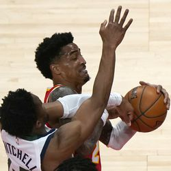 Atlanta Hawks forward John Collins (20) and Utah Jazz guard Donovan Mitchell (45) battle for a rebound in the first half of an NBA basketball game Thursday, Feb. 4, 2021, in Atlanta.