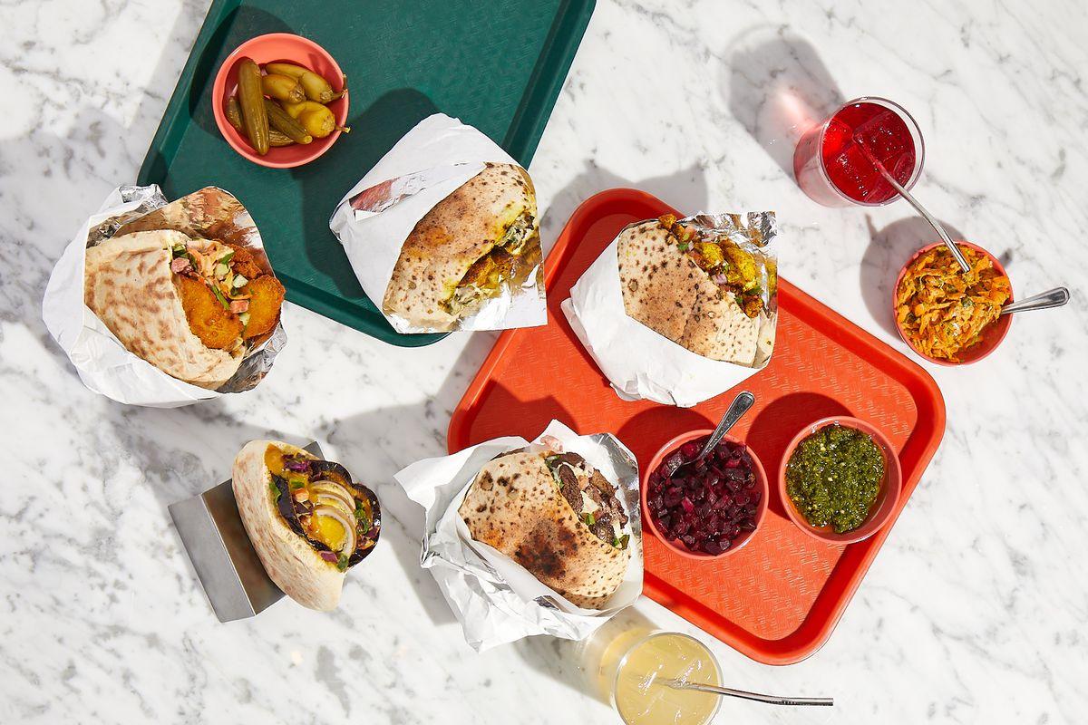 trays with pita sandwiches
