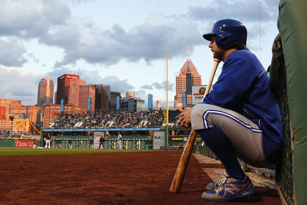 Pitcher R.A. Dickey squats in contemplation as the Toronto Blue Jays play the Pittsburgh Pirates at PNC Park in Pittsburgh, Pennsylvania.