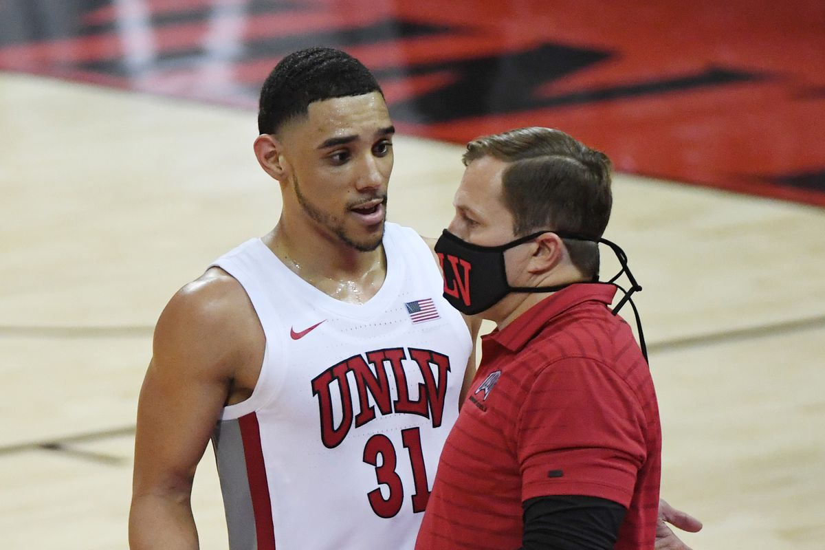 Marvin Coleman of the UNLV Rebels talks to head coach T.J. Otzelberger after Coleman fouled out of a game against the Montana State Bobcats at the Thomas & Mack Center on November 25, 2020 in Las Vegas, Nevada.