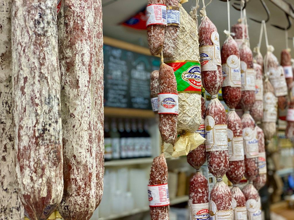 Salami hanging from the ceiling at Lucca Deli