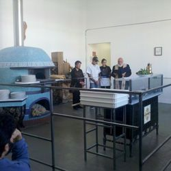 In a bizarre and interesting twist, a priest gave a mini ceremony and blessing of the 5,000 pound tiled pizza oven from Naples