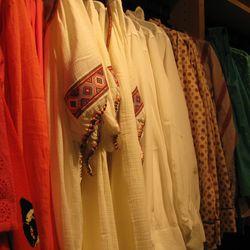 Silk blouses start at $79.99, linen blouses start at $39.99.