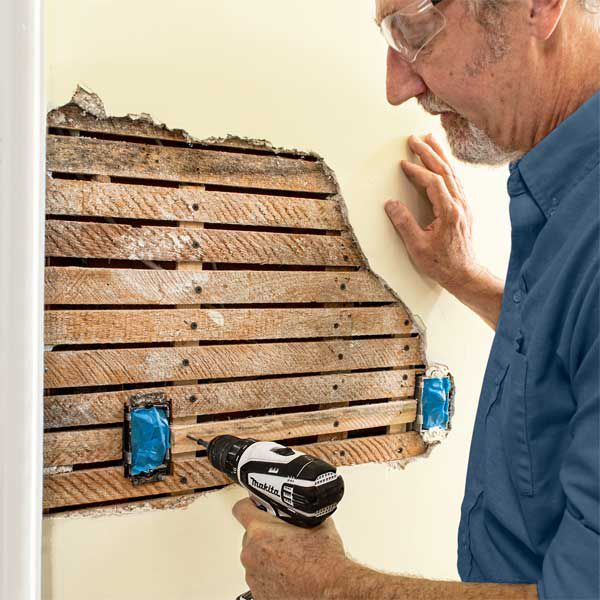 Person uses drill on lath.
