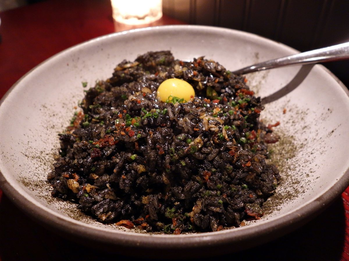 Squid ink fried rice with a smoked quail egg at Paju.