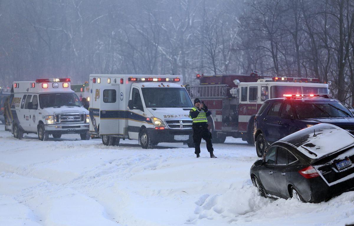 <small><strong>A vehicle rest along the median at the scene of a series of crashes along Interstate 94, Friday, Jan. 9, 2015, between mile markers 88 and 92 in eastern Kalamazoo County, near Galesburg, Mich. | Mark Bugnaski . AP</strong></small>
