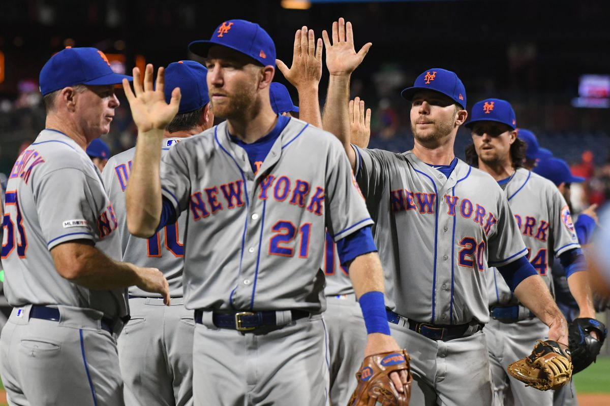 Mets first baseman Pete Alonso and third baseman Todd Frazier are congratulated after defeating the Philadelphia Phillies at Citizens Bank Park in Philadelphia, Pennsylvania.