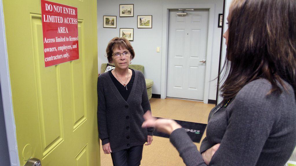 Judy Negley, left, co-owner of Indispensary, a medical marijuana dispensary in Colorado Springs, talks to manager Christy Kress. Photo by Joe Mahoney / I-News