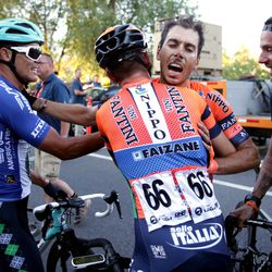 Marco Canola of team Nippo-Vini Fantini-Faizane celebrates with teammate No. 66 Filippo Fiorelli after winning Stage 4 of the Tour of Utah in Salt Lake City on Friday, Aug. 16, 2019.