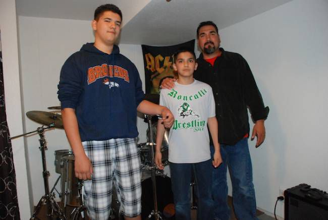 Geno Duran, right, with his Roncalli Middle School students, Jeremy, left, and Anthony.