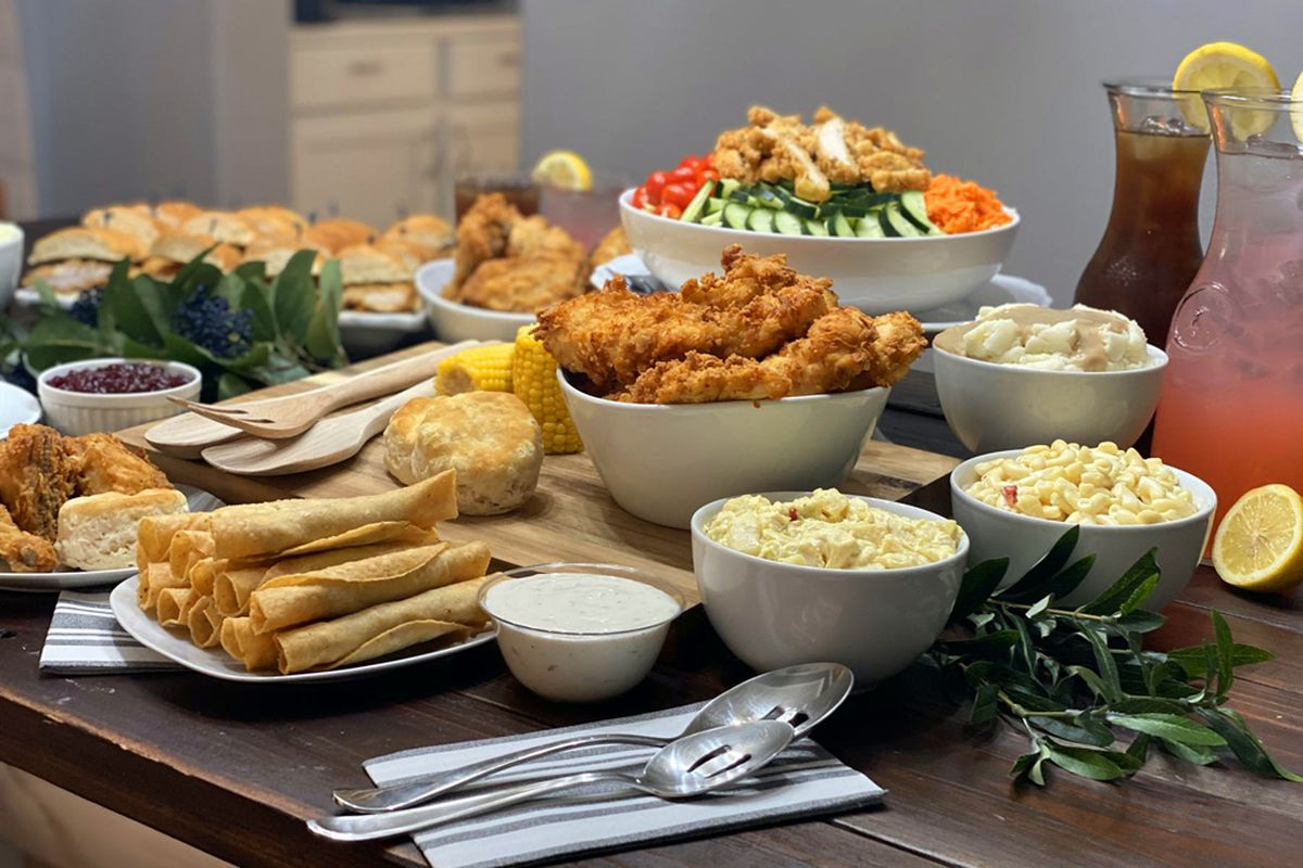 A table filled with clucker sandwiches, gobbler specials and clucketo chicken tacos, from the famous Farm Basket menu.