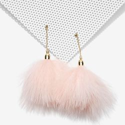 Feathers? Baby pink? A little swing? This is a lot of earring for $18 — a bargain statement, if you will.