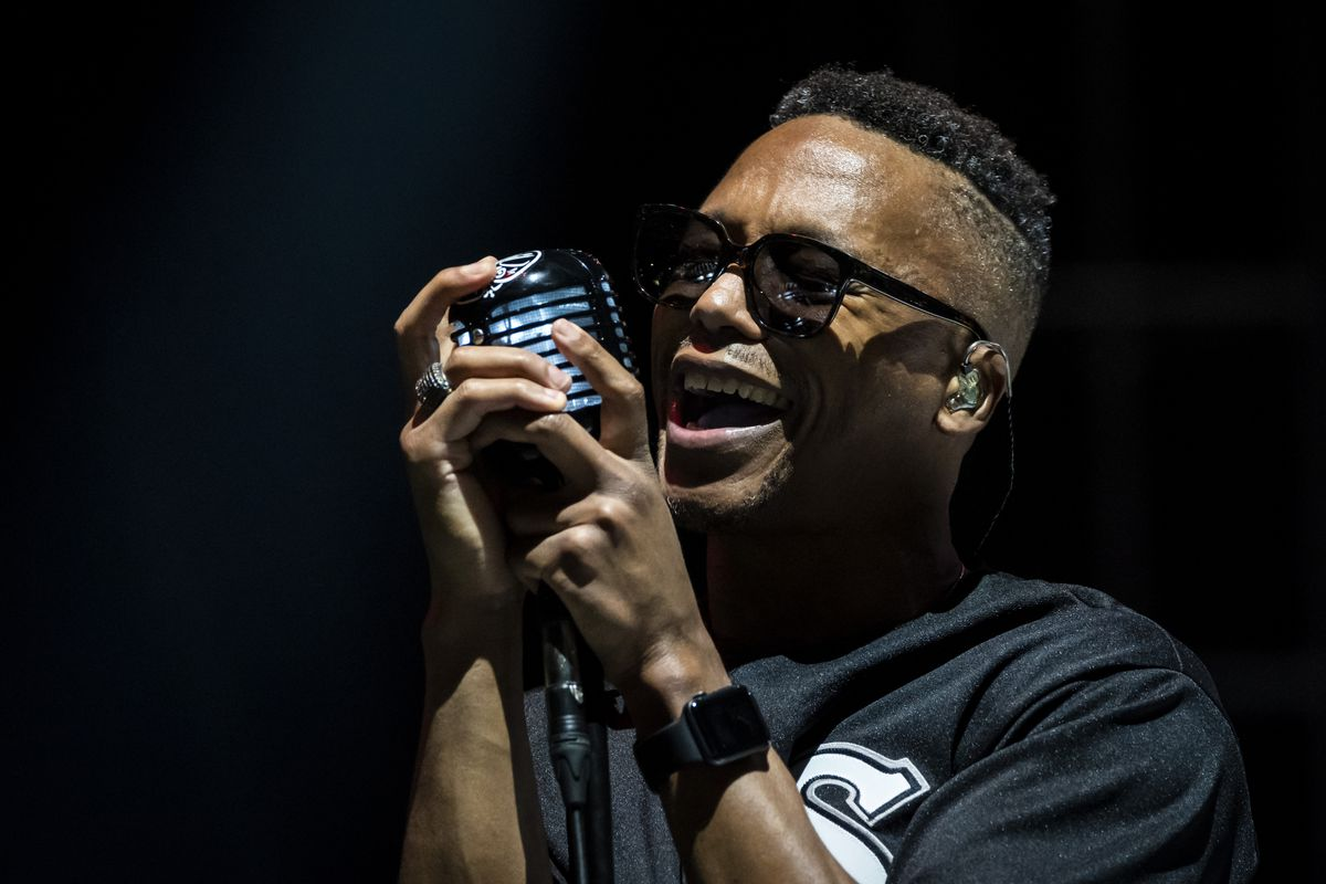 Lupe Fiasco performs in the rain Friday night on Day 2 of Riot Fest in Douglass Park.