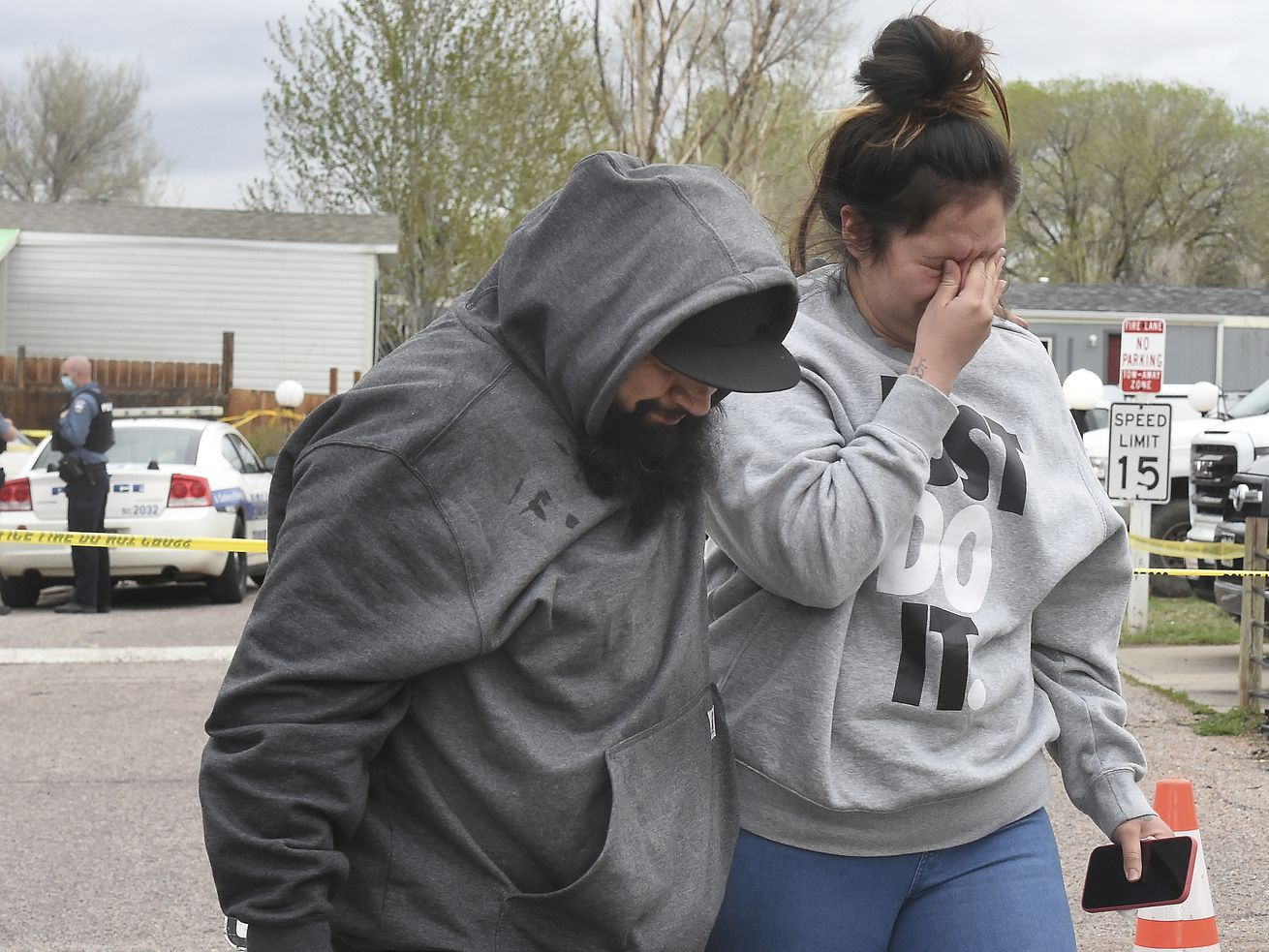 Freddy Marquez and his wife, Nubia Marquez, near the scene where her mother and other family members were killed in a mass shooting early Sunday, May 9, 2021, in Colorado Springs, Colo.