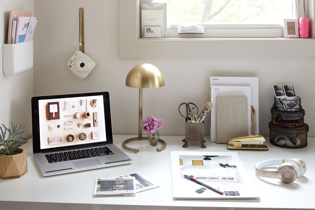 Shorthouse's desk is pretty due to the fact she buys workaday items such as a brass stapler that are inherently attractive.
