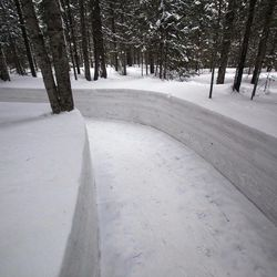 In this Monday, April 2, 2012 photo, a path cuts through deep snow at a former secret military camp during the fight against the Japanese and the site of what North Koreans say is the home of the late North Korean leader Kim Il Sung and the birthplace of his son and late leader Kim Jong Il at the foot of Mount Paektu, North Korea.
