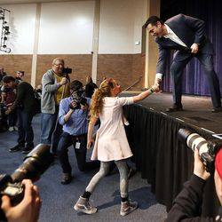 Hannah Bradshaw shakes hands with Rep. Jason Chaffetz, R-Utah, after asking him a question during a town hall meeting in Cottonwood Heights on Thursday, Feb. 9, 2017.