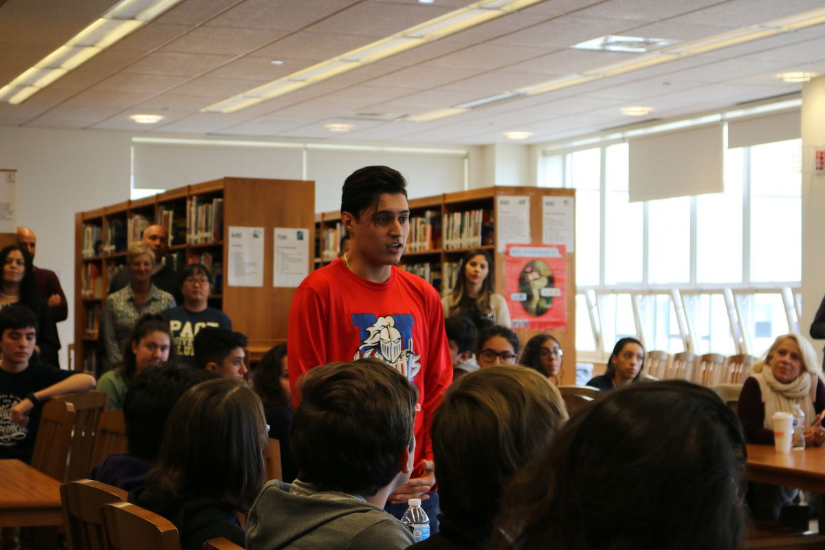 Kevin Flores, a then-senior at Queens Metropolitan High School, talks in 2018 about help college counselors provided for his parents, who are immigrants, to help navigate the college admissions process.