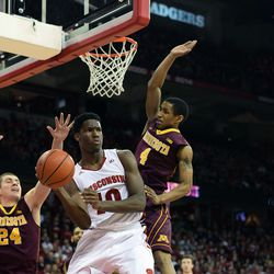 Nigel Hayes passes the dishes the ball away, faking out Minnesota's DeAndre Mathieu