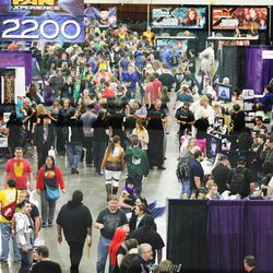 Attendees walk through Comic Con at the Salt Palace in Salt Lake City Thursday, April 17, 2014.