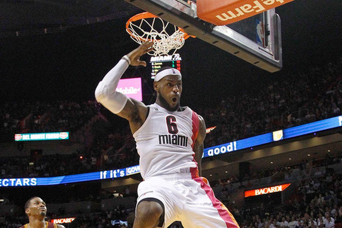 LeBron James dunks the ball.