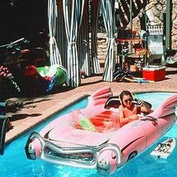 And finally, the movie that launched a thousand whale dreams. It's funny becuase we, too, would probably spring for the pink car float over most things. Blank Check (1994)