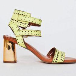 "<b>Dolce Vita</b> Elka Sandal at <b>Crush Boutique</b>, <a href=""http://www.shopcrushboutique.com/accessories/shoes/dolce-vita-elka-sandal-in-acid-yellow.html"">$158</a>"