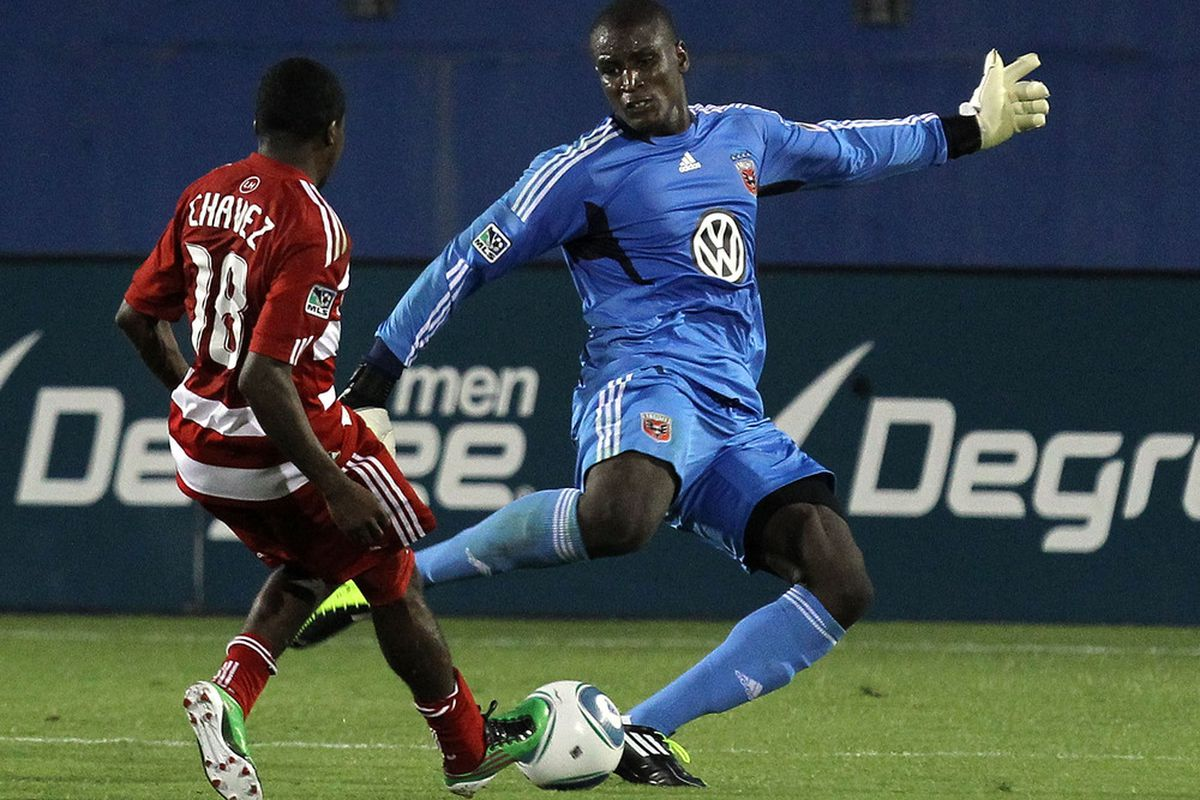 FRISCO, TX - JULY 16:  Bill Hamid #28 of the D.C. United dribbles the ball past Marvin Chavez #18 of the FC Dallas at Pizza Hut Park on July 16, 2011 in Frisco, Texas.  (Photo by Ronald Martinez/Getty Images)