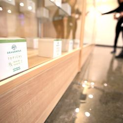Workers get Items in display cases set and ready for purchase as Dragonfly Wellness in Salt Lake City prepares to open as the first of Utah's 14 medical cannabis pharmacies on Monday, March 2, 2020.