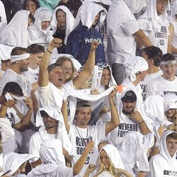 Utah State students brave the rain during a lightning delay before an NCAA college football game against North Dakota, Friday, Sept. 10, 2021, in Logan, Utah.