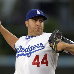 Los Angeles Dodgers starting pitcher Aaron Harang throws to the plate during the first inning of their baseball game against the Arizona Diamondbacks, Friday, Aug. 31, 2012, in Los Angeles.