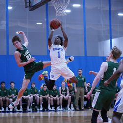Proviso East's Devin Spencer (1) almost gets his shot blocked by Lane's Louis Perona (23), Wednesday 02-27-19. Worsom Robinson/For Sun-Times