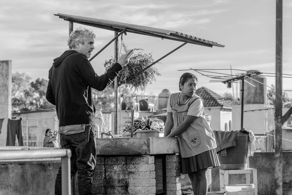 A man and a woman standing outside in 'Roma'