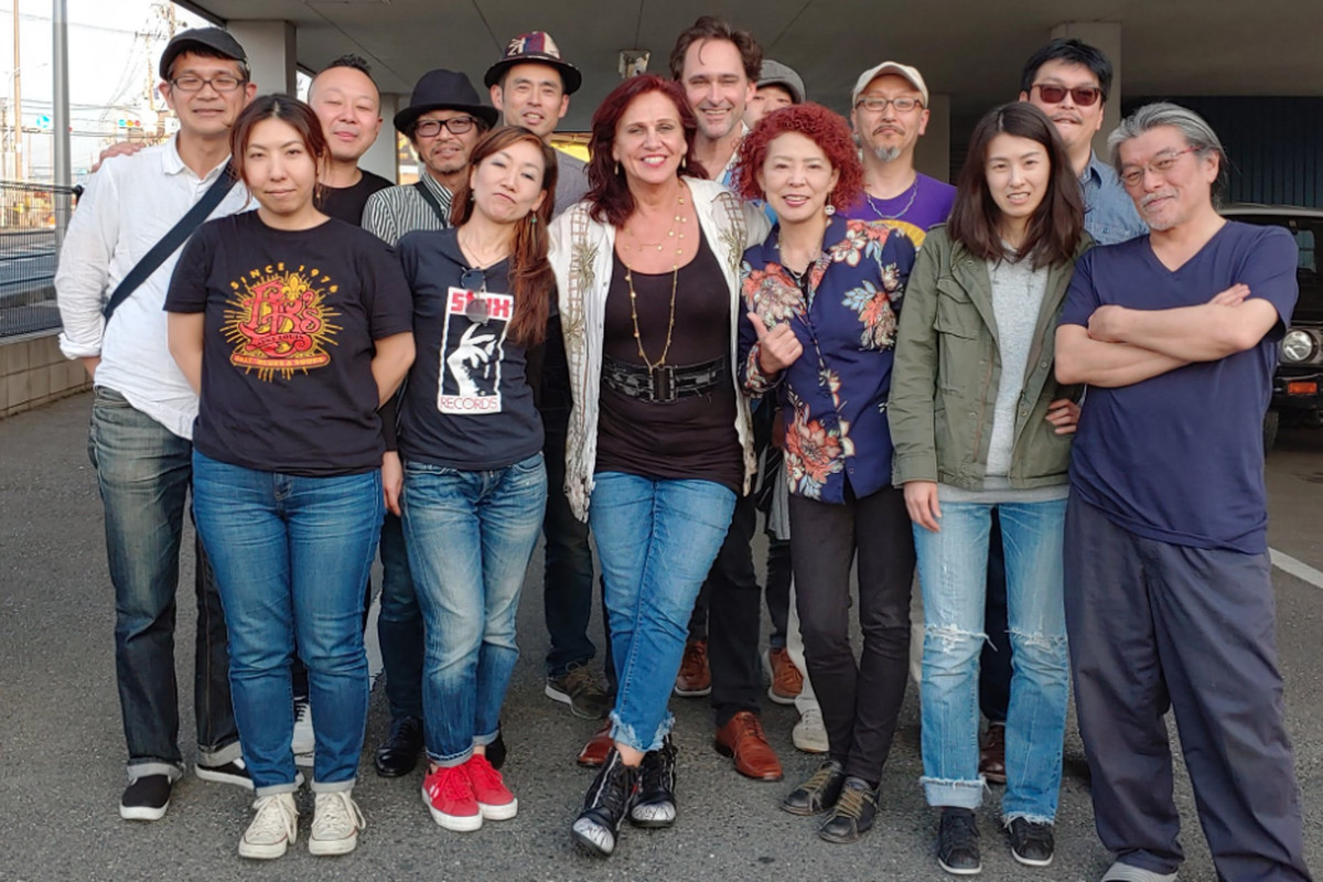 """A group of Japanese blues artists who are influenced by the Chicago scene were brought on to create """"No Border Blues Japan,"""" a compilation orchestrated by Johnny Burgin (back row, center), a Chicago-based bluesman."""