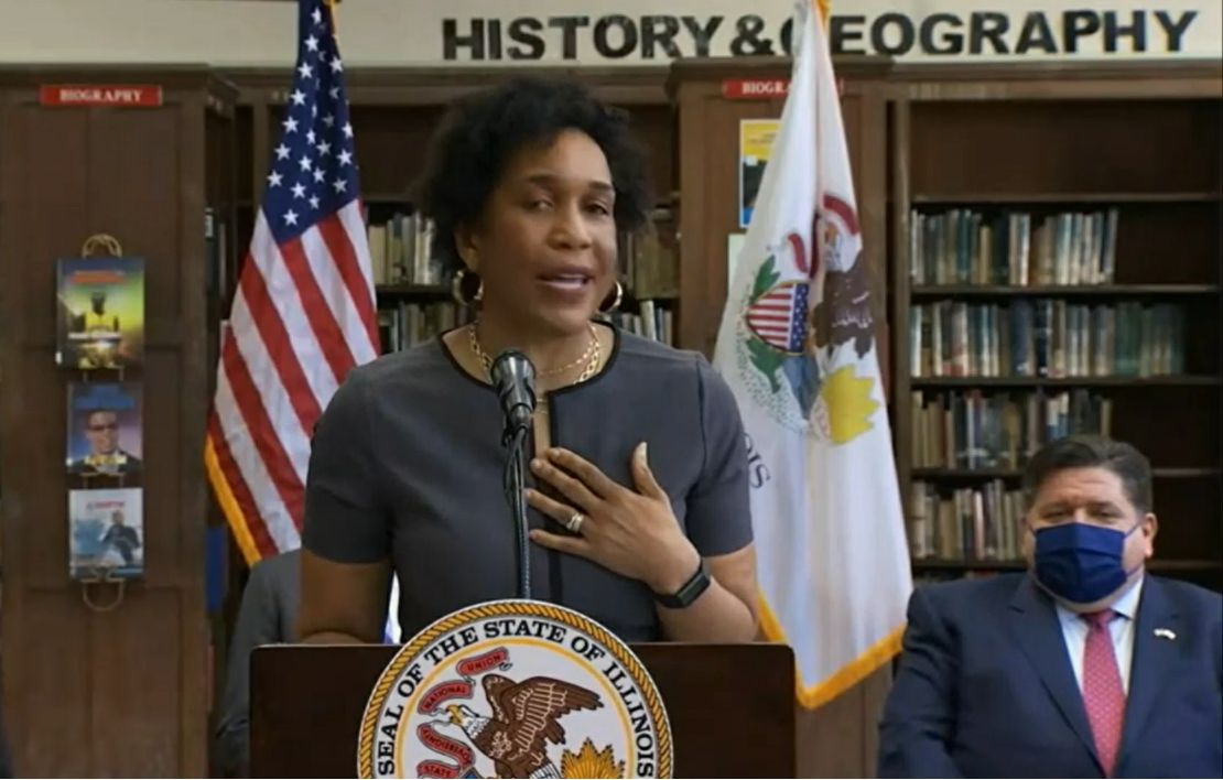 Lt. Gov. Juliana Stratton discusses the Education and Workforce Equity Act shortly before Gov. J.B. Pritzker, right, signed it at Proviso East High School on Monday.