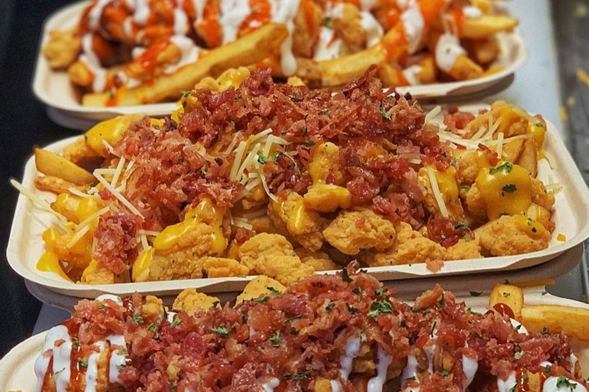 Loaded fries with shrimp, chicken, bacon, and steak, on the menu at Mr Fries Man.