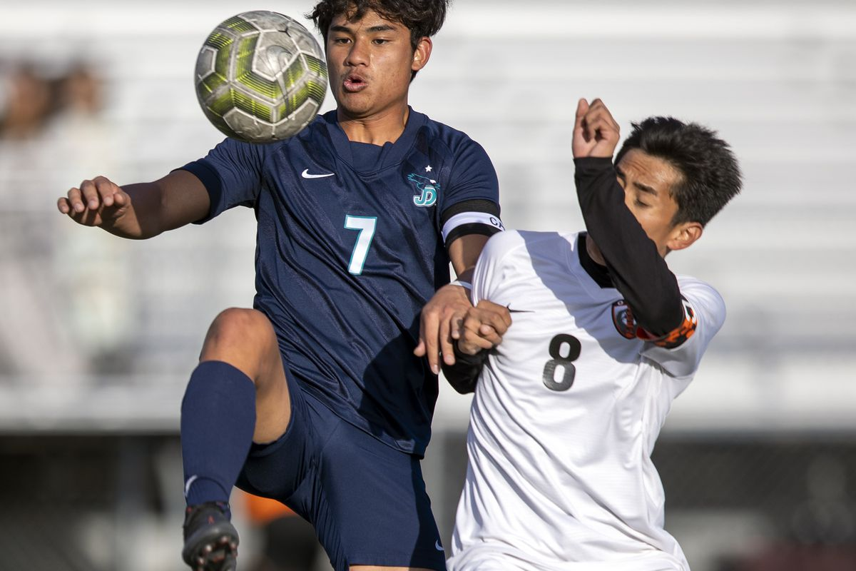 Juan Diego's Niihau Siaou Chin and Ogden's Eli Paredes go after the ball at Juan Diego.
