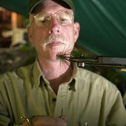 """Lee Spencer ties a moose hair muddler fly. """"It is my impression that the less harming or the more harmless my actions are in the world, the better,"""" he says."""