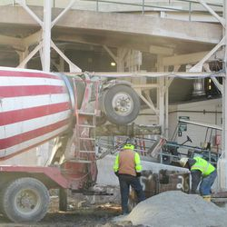 A closer view of the concrete truck, working in right center field along Sheffield