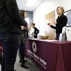 Theresa Drulard, right, of the Refugee & Immigrant Center Asian Association of Utah talks to potential volunteers during a volunteer open house event at the Utah Refugee Education and Training Center in Salt Lake City, Saturday, Jan. 9, 2016.