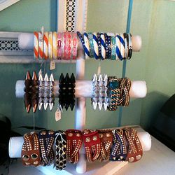 Spike bracelets are $10 to $15, bangles are $12, and leather cuffs are $20.