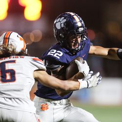 Brighton's Owen Powers runs the ball for a first down during a high school 5A football quarterfinal against Timpview at Brighton High School in Cottonwood Heights on Friday, Nov. 6, 2020.