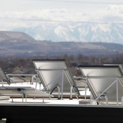Solar panels line the rooftops at Garbett Homes in South Jordan on Tuesday, March 12, 2013.