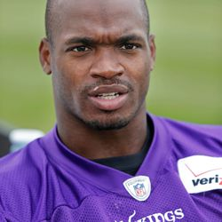 Jul 27, 2013; Mankato, MN, USA; Minnesota Vikings running back Adrian Peterson (28) talks with a reporter after drills at training camp at Blakeslee Fields. Mandatory Credit: Bruce Kluckhohn-USA TODAY Sports