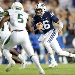 BYU quarterback Baylor Romney (16) takes off on a run as the Cougars and USF Bulls play a college football game at LaVell Edwards Stadium in Provo on Saturday, Sept. 25, 2021.