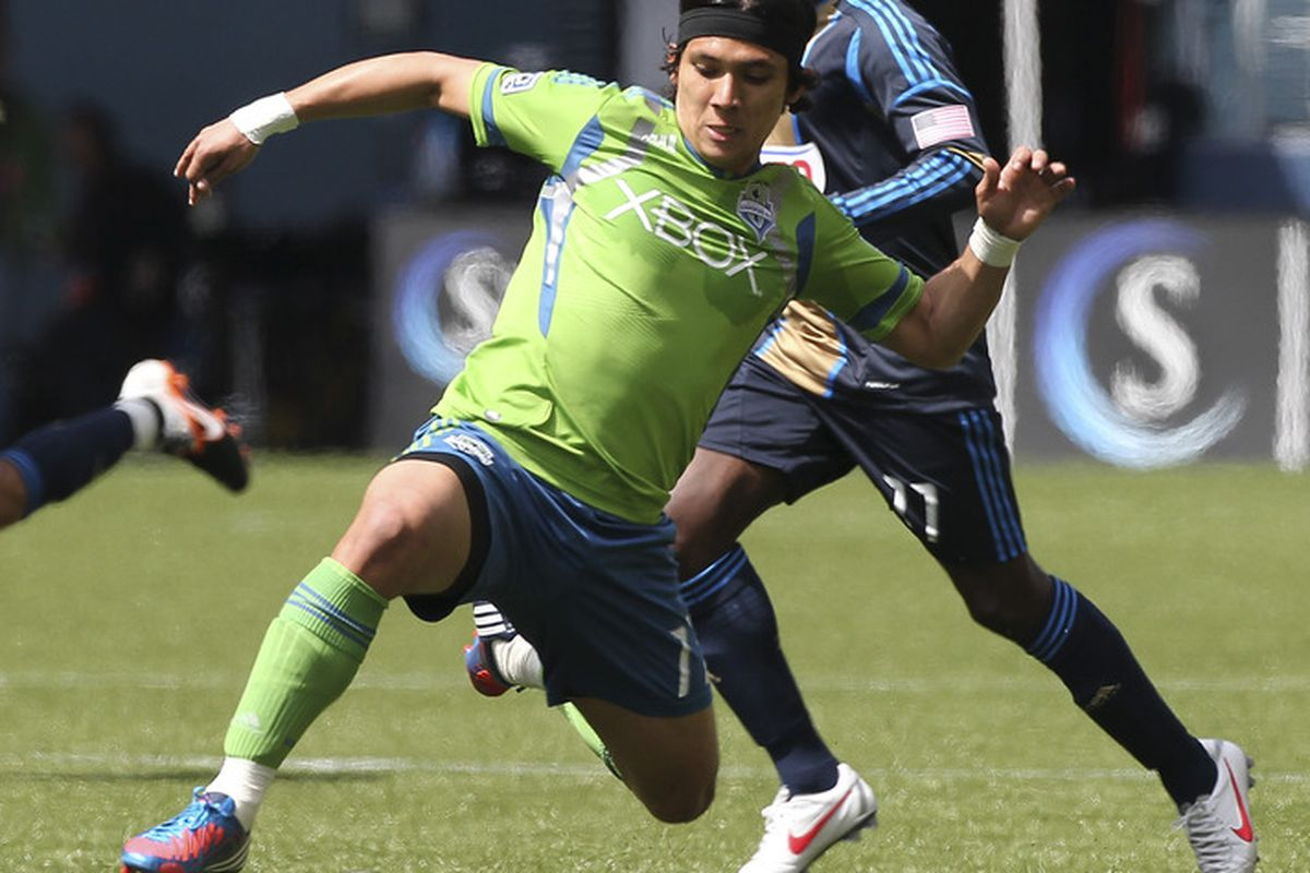 SEATTLE, WA - MAY 05:  Fredy Montero #17 of the Seattle Sounders controls the ball against Freddy Adu #11 of the Philadelphia Union at CenturyLink Field on May 5, 2012 in Seattle, Washington. (Photo by Otto Greule Jr/Getty Images)